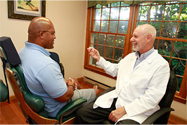 Dr. Raymond Munz with patient